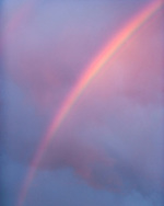 Ranibow segmet with the last light of sunset on storm clouds at sunset, WYOMING, © 2005 David A. Ponton