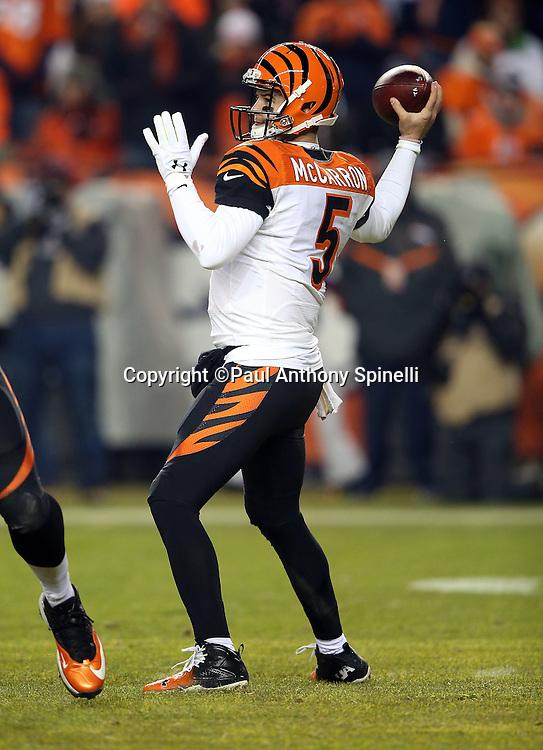 Cincinnati Bengals quarterback AJ McCarron (5) throws a pass during the 2015 NFL week 16 regular season football game against the Denver Broncos on Monday, Dec. 28, 2015 in Denver. The Broncos won the game in overtime 20-17. (©Paul Anthony Spinelli)