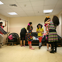 "Members of The Palestinian Circus School prepare themselves behind the scenes, before going on stage to perform the show ""Circus behind the wall"" in Ramallah, November 20, 2009.The circus group was established in 2006, in order to give a new way of expression for Palestinians, and a new way to deliver the idea of resistance to the occupation. This performance is based on the life of Palestinians behind the separation wall. Photo by Michal Fattal/backyard"