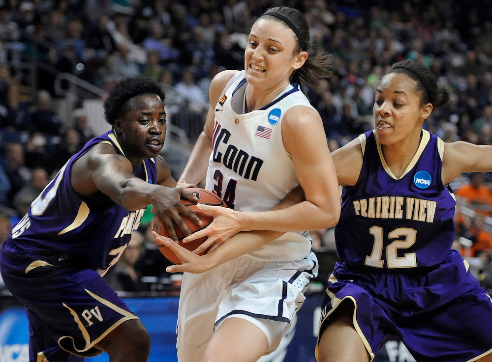 Connecticut's Kelly Faris, center, is pressured by Prairie View A&M's JaQuandria Williams, left, and Michaela Burton, right, during the first half of an NCAA tournament first-round college basketball game in Bridgeport, Conn., Saturday, March 17, 2012. (AP Photo/Jessica Hill)