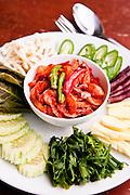 Nam prik:<br /> Fern tips, cucumber, white turmeric, snake bean, cashew leaf, snake gourd, pickled giant bean sprouts  at Raya resaurant, Phuket.
