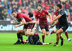 Munster's Chris Farrell is tackled by Ospreys' Sam Davies - Mandatory by-line: Craig Thomas/JMP - 16/09/2017 - RUGBY - Liberty Stadium - Swansea, Wales - Ospreys Rugby v Munster Rugby - Guinness Pro 14