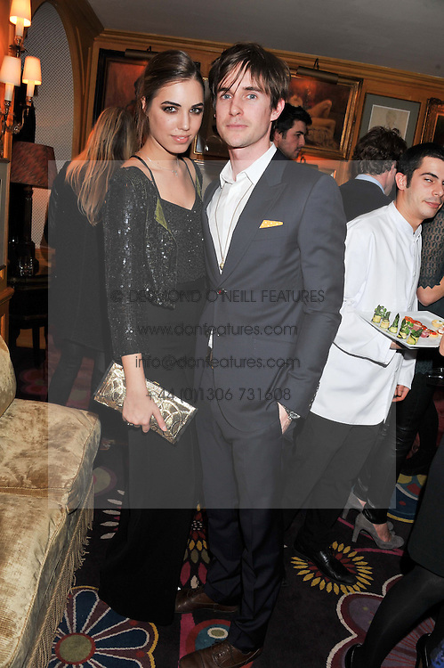 AMBER LE BON and JONNY HYNES at the Johnnie Walker Blue Label and David Gandy partnership launch party held at Annabel's, 44 Berkeley Square, London on 5th February 2013.