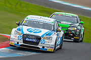 Mark BLUNDELL (GBR)(#8) of TradePriceCars.com exits chicane closely followed by Sam OSBORNE (GBR)(#4) of Excelr8 Motorsport during Round 22 of the 2019 British Touring Car Championship at Knockhill Racing Circuit, Dunfermline, Scotland on 15 September 2019.