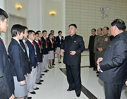 59584165  .The photo provided by KCNA on April 30, 2013 shows top leader of the Democratic Peoples Republic of Korea (DPRK) Kim Jong Un meeting with gold medalists in international competitions in Pyongyang, capital of the DPRK, on April 29, 2013, 30, April 2013. Photo by: i-Images.UK ONLY