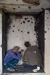 November 20, 2018 - Srinagar, Jammu & Kashmir, India - Kashmiri residents are seen inspecting a damaged house after a gun battle..Four militants and an Indian Armyman killed in a Gunbattle between Indian Troops and Militants at south Kashmir's Shopian district some 80 Kms from summer capital srinagar. (Credit Image: © Idrees Abbas/SOPA Images via ZUMA Wire)