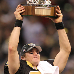 Jan 24, 2010; New Orleans, LA, USA; New Orleans Saints quarterback Drew Brees (9) celebrates following a 31-28 overtime victory by the New Orleans Saints over the Minnesota Vikings in the 2010 NFC Championship game at the Louisiana Superdome. Mandatory Credit: Derick E. Hingle-US PRESSWIRE
