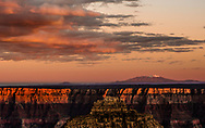 Snow-capped Humphrey's Peak is set off by a glorious sunset over the Grand Canyon, as viewed from the Cape Royal viewpoint on the north rim.