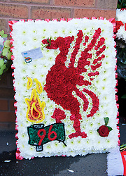 LIVERPOOL, ENGLAND - Saturday, April 11, 2009: Liverpool supporters leave floral tributes at the memorial to the 96 supporters who lost their lives at the Hillsborough Stadium Disaster on 15th April 1989. Twenty years on the victims families are still waiting for justice as none of the police officers responsible for the deaths of so many supoporters have ever been brought to justice. (Photo by: David Rawcliffe/Propaganda)