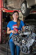 Northside High School student April Reyes poses for a photograph in an auto mechanics class at the Barbara Jordan High School for Careers, November 21, 2016.