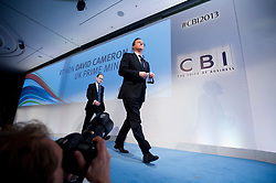 © London News Pictures. 04/11/2013 . London, UK.  British Prime Minister DAVID CAMERON arriving on stage before delivering a speech at the 2013 Confederation of British Industry (CBI) Conference, held at the Hilton Metropole in London. . Photo credit : Ben Cawthra/LNP