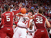 FAYETTEVILLE, AR - DECEMBER 30:   Michael Sanchez #31 of the Arkansas Razorbacks fights for a rebound against the Oklahoma Sooners at Bud Walton Arena on December 30, 2008 in Fayetteville, Arkansas.  The Razorbacks defeated the Sooners 96-88.  (Photo by Wesley Hitt/Getty Images) *** Local Caption *** Michael SanchezUniversity of Arkansas Razorback Men's and Women's athletes action photos during the 2008-2009 season in Fayetteville, Arkansas....©Wesley Hitt.All Rights Reserved.501-258-0920.