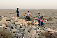 Kids in Abu Tlul, an unrecognized Bedouin village in Israel's Negev Desert, play on the ruins of a house demolished by the Israeli government. Many children - and adults - have been traumatized by the demoltions of their homes and villages.