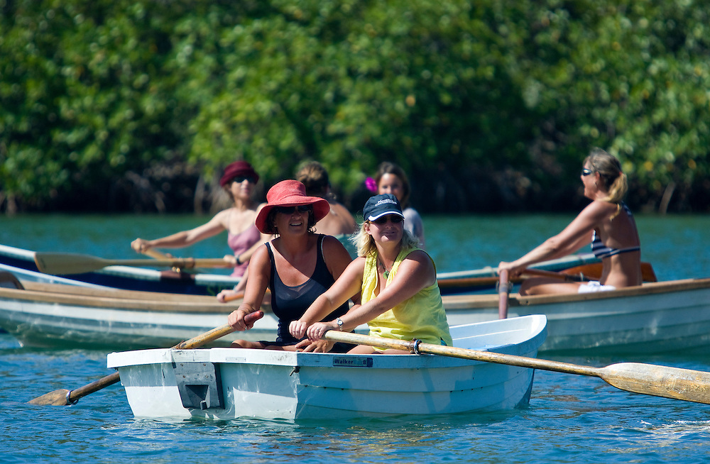 Two women preparing to race rowing dinghies during the 2008 Antigua Classic Yacht Regatta . This race is one of the worlds most prestigious traditional yacht races. It takes place annually off the cost of Antigua in the British West Indies. Antigua is a yachting haven, historically a British navy base in the times of Nelson.