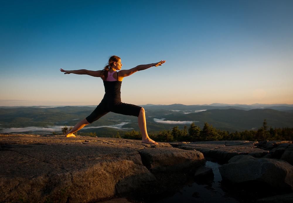 The sun comes up on a mountain Yogi.