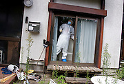 A man locks windows of the living room after he and around 160 other residents were allowed briefly to collect valuables and other belongings from their homes inside the nuclear exclusion zone  in Okuma, Fukushima Prefecture, Japan on Aug. 31 2011. For many this was the first time to visit homes since being evacuated in March. Robert Gilhooly Photo