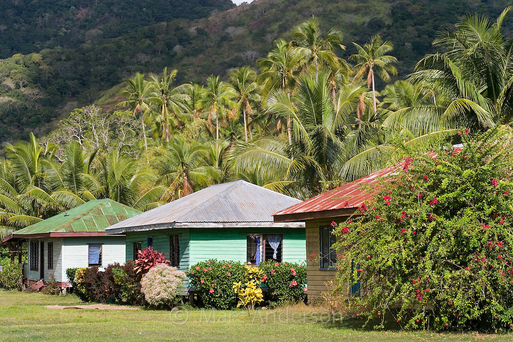 Colourful village houses in a small village in Vanua Levu, Fiji..