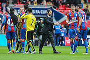 Quique Sanchez Flores sportingly congratulating the Crystal Palace players during the The FA Cup match between Crystal Palace and Watford at Wembley Stadium, London, England on 24 April 2016. Photo by Shane Healey.