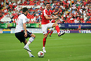 Charlton Athletic midfielder Johnnie Jackson (4) trying to tackle Bolton Wanderers defender Lewis Buxton (2) during the EFL Sky Bet Championship match between Charlton Athletic and Bolton Wanderers at The Valley, London, England on 27 August 2016. Photo by Matthew Redman.