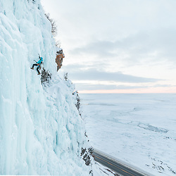 Nathalie Fortin ice climbing Meduse, WI4 in Gaspesie, Quebec, Canada.