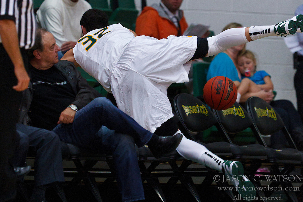 Nov 16, 2011; San Francisco CA, USA;  San Francisco Dons forward Angelo Caloiaro (32) dives into the stands for a loose ball against the San Jose State Spartans during the first half at War Memorial Gym.  Mandatory Credit: Jason O. Watson-US PRESSWIRE