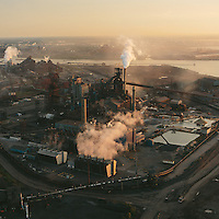 The Indiana Harbor and Ship Canal, the largest integrated steelmaking facility in North America, juts out into Lake Michigan and lays 3 miles northeast of the West Calumet Housing Complex. The peninsula is completely manmade, using landfill and industrial byproduct for its foundation.