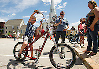 """Gabriel Bates had tried his hand at the """"slow race"""" in Veteran's Square but was too fast on his West Coast Choppers bicycle Thursday afternoon.    (Karen Bobotas/for the Laconia Daily Sun)"""