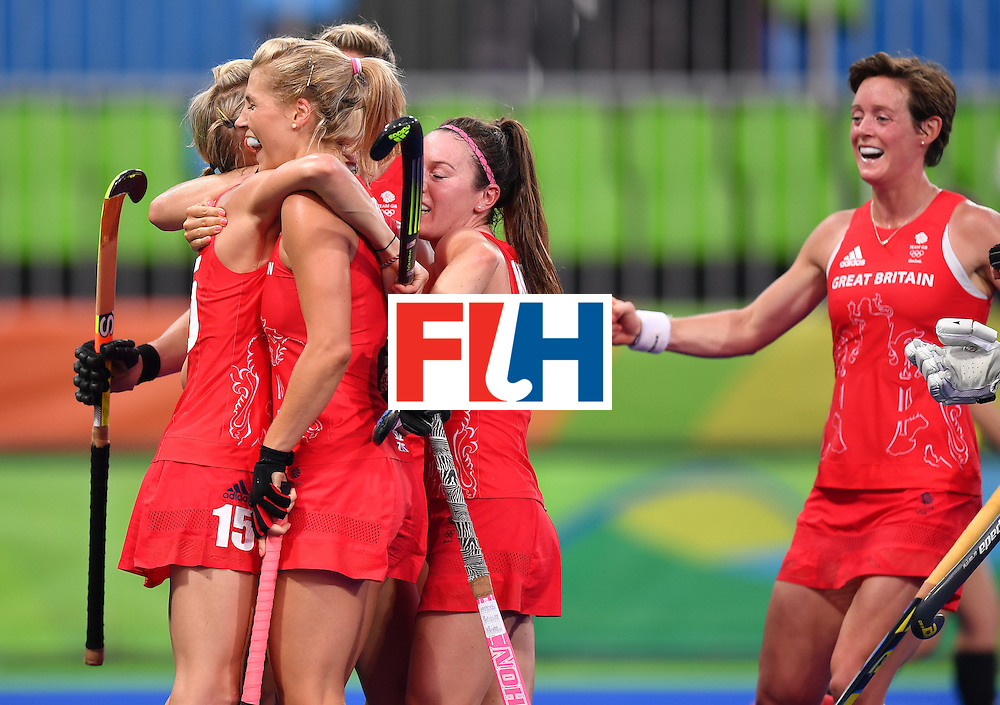 Britain's players celebrate the opening goal during the women's semifinal field hockey New Zealand vs Britain match of the Rio 2016 Olympics Games at the Olympic Hockey Centre in Rio de Janeiro on August 17, 2016. / AFP / MANAN VATSYAYANA        (Photo credit should read MANAN VATSYAYANA/AFP/Getty Images)
