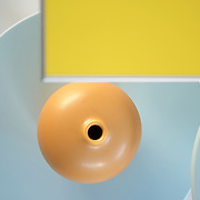 overhead detail view of contemporary yellow table,round tables and vase.