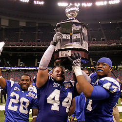Dec 20, 2009; New Orleans, LA, USA; Middle Tennessee State Blue Raiders defensive tackle Dwight Smith (47) and linebacker Danny Carmichael (44) and Sherman Neal (28) celebrate with the trophy following the 2009 New Orleans Bowl at the Louisiana Superdome. Middle Tennessee State defeated Southern Miss 42-32. Mandatory Credit: Derick E. Hingle-US PRESSWIRE