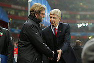 Manager of Arsenal, Arsene Wenger and Manager of Borussia Dortmund, Jurgen Klopp shake hands before the UEFA Champions League match at the Emirates Stadium, London<br /> Picture by Richard Calver/Focus Images Ltd +447792 981244<br /> 26/11/2014
