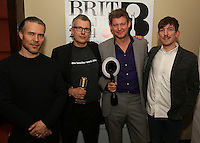 Christian Tattersfield (BRITs Chairman), Flood (Mark Ellis) & Alan Moulder UK Producer of the year winners and Edwin Congreave (Foals) - (L to R). The Music Producers Guild Awards, Park Plaza Riverbank London :Thursday, Feb 13. 2014 (Photo John Marshall/JM Enternational)