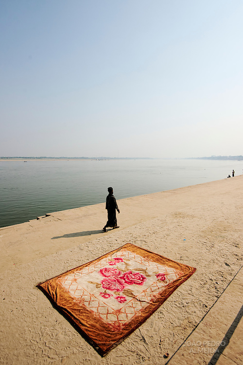 Holy man lingering the ghats of Varanasi.