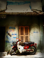 Motorbike parked in front of a weathered wall, Hanoi, Vietnam, Southeast Asia