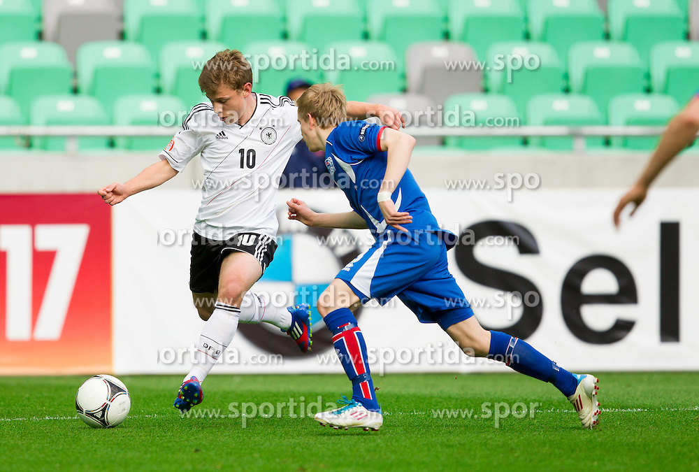 Maximilian Meyer of Germany vs Osvald Jarl Traustason of Iceland  during the UEFA European Under-17 Championship Group A match between Iceland and Germany on May 7, 2012 in SRC Stozice, Ljubljana, Slovenia. (Photo by Vid Ponikvar / Sportida.com)