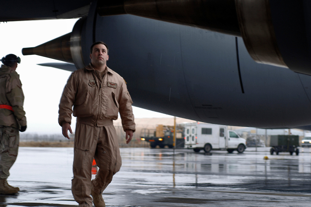Major Daniel Arch (right), instructor pilot performs a preflight walk-around inspection of a KC-135T/R Stratotanker for an aerial refueling mission in Southwest Asia. His flight crew and he will take the tanker to a speed greater than 250 knots and deliver more than 40,000 pounds of fuel to a RC-135 Rivet Joint reconnaissance aircraft. This will allow it to remain on station or move on to other stations to perform its airborne mission. The tanker and crew are deployed to the 22nd Expeditionary Air Refueling Squadron, Manas Air Base, Kyrgyz Republic, from the 92nd Air Refueling Squadron, Fairchild Air Force Base, Wash. Major Arch is a native of Hackettstown, NJ. (U.S. Air Force photo by Master Sgt. Lance Cheung)<br />