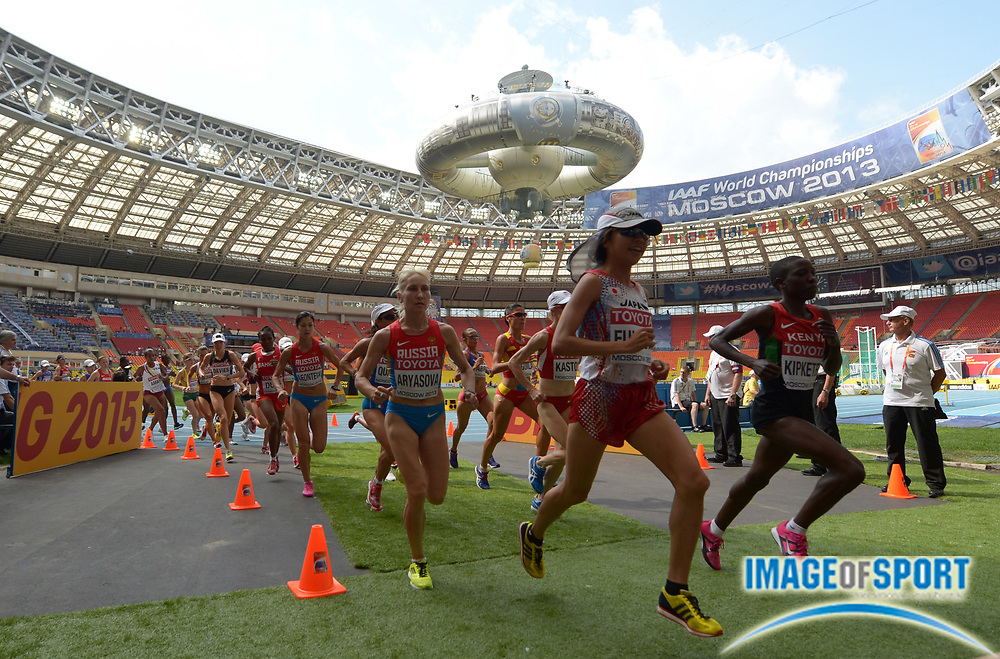 Aug 10, 2013; Moscow, RUSSIA; Runners leave Luzhniki Stadium at the start of the womens marathon  in the 14th IAAF World Championships in Athletics at Luzhniki Stadium.