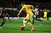 Milton Keynes Dons midfielder Daniel Powell driving into the box to try and rescue something during the Sky Bet Championship match between Brentford and Milton Keynes Dons at Griffin Park, London, England on 5 December 2015. Photo by Matthew Redman.