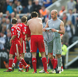NEWCASTLE-UPON-TYNE, ENGLAND - Sunday, April 1, 2012: Liverpool's Jose Enrique takes the goalkeepr shirt from goalkeeper Jose Reina after the 'keeper was sent off against Newcastle United during the Premiership match at St James' Park. (Pic by David Rawcliffe/Propaganda)