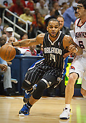 24 April 2011: Orlando's Jameer Nelson (14) is being defended by Atlanta's Kirk Hinrich in Atlanta Hawks 88-85 victory over the Orlando Magic in Eastern Conference First Round Game 4 at Philips Arena in Atlanta, GA.