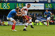 Charlie Wyke (9) of Bradford City puts himself between the ball and Matt Clarke (5) of Portsmouth during the EFL Sky Bet League 1 match between Portsmouth and Bradford City at Fratton Park, Portsmouth, England on 28 October 2017. Photo by Graham Hunt.