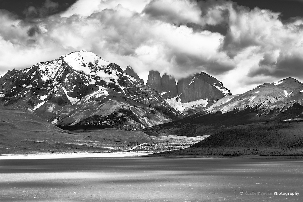 The first real view of the towers, taken from a viewing point on the far shore of Laguna Amargo.