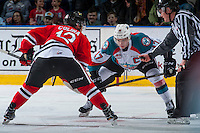 KELOWNA, CANADA - JANUARY 28: Ilijah Colina #12 of the Portland Winterhawks faces off against Rodney Southam #17 of the Kelowna Rockets on January 28, 2017 at Prospera Place in Kelowna, British Columbia, Canada.  (Photo by Marissa Baecker/Shoot the Breeze)  *** Local Caption ***