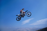 Man jumping on motorbike