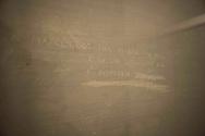 Roma 28 Maggio 2010.Museo Storico della Liberazione .Via Tasso 155,  era il Comando SS e Gestapo, della polizia Nazista  durante l'occupazione da parte delle  Germania durante la Seconda Guerra Mondiale..Le celle dove venivano tenuti i combattenti della resistenza romana. Le scritte sui muri di una cella fatte dai prigionieri..Rome, May 28, 2010.Historical Museum of the Liberation.Via Tasso 155, was the SS and Gestapo Command, the police during the Nazi occupation by Germany during the Second World War..The cells were kept where resistance fighters Roman. The graffiti made by prisoners in a cell