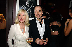 SALLY GREEN and DAVID FURNISH at a Black, White and Gold party to celebrate the December 'Party' issue of Harper's Bazaar featuring the 'Going Out' Guide in association with Moet & Chandon  held at Ronnie Scotts, 47 Frith Street, London on 16th November 2006.<br />