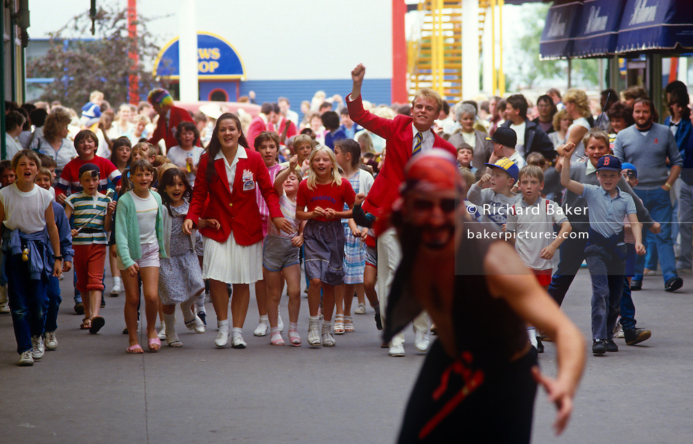 Led by Red Coats, children chase pirates during their stay at the regenerated Butlins holiday centre at Minehead.