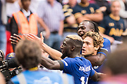 Chelsea (3) Marcos Alonso, Chelsea (14) Tiémoué Bakayoko, Chelsea (15) Victor Moses celebrate winning goal together with fans during the Premier League match between Tottenham Hotspur and Chelsea at Wembley Stadium, London, England on 20 August 2017. Photo by Sebastian Frej.