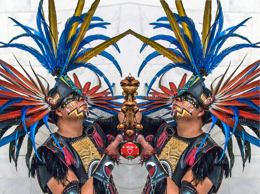 Mirror image  portrait of Naz Cruz,dance in group Danza Mexikah,after ceremonial dance on the Day of the Dead on the rotunda in the National Museum of the American Indians.<br /> <br /> Cetiliztli Nauhcampa Quetzacoatl in Ixachitlan (Group of the Four Directions on the East of the Continent)  a cultural, spiritual, artistic, political and educational circle made up of community and family members who carry on their ethnic pride and the ancient traditions of native people's of this continent.
