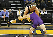 December 8, 2011: Northern Iowa Panthers Ryan Loder dives for Iowa Hawkeyes Vinnie Wagner in the 184 pound bout of the NCAA wrestling dual between the Northern Iowa Panthers and the Iowa Hawkeyes at Carver-Hawkeye Arena in Iowa CIty, Iowa on Thursday, December 8, 2011. Loder defeated Wagner 13-2 and Iowa defeated Northern Iowa 38-4.